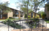 custom ipe and steel bridge over dry creek - the grove apartments, austin