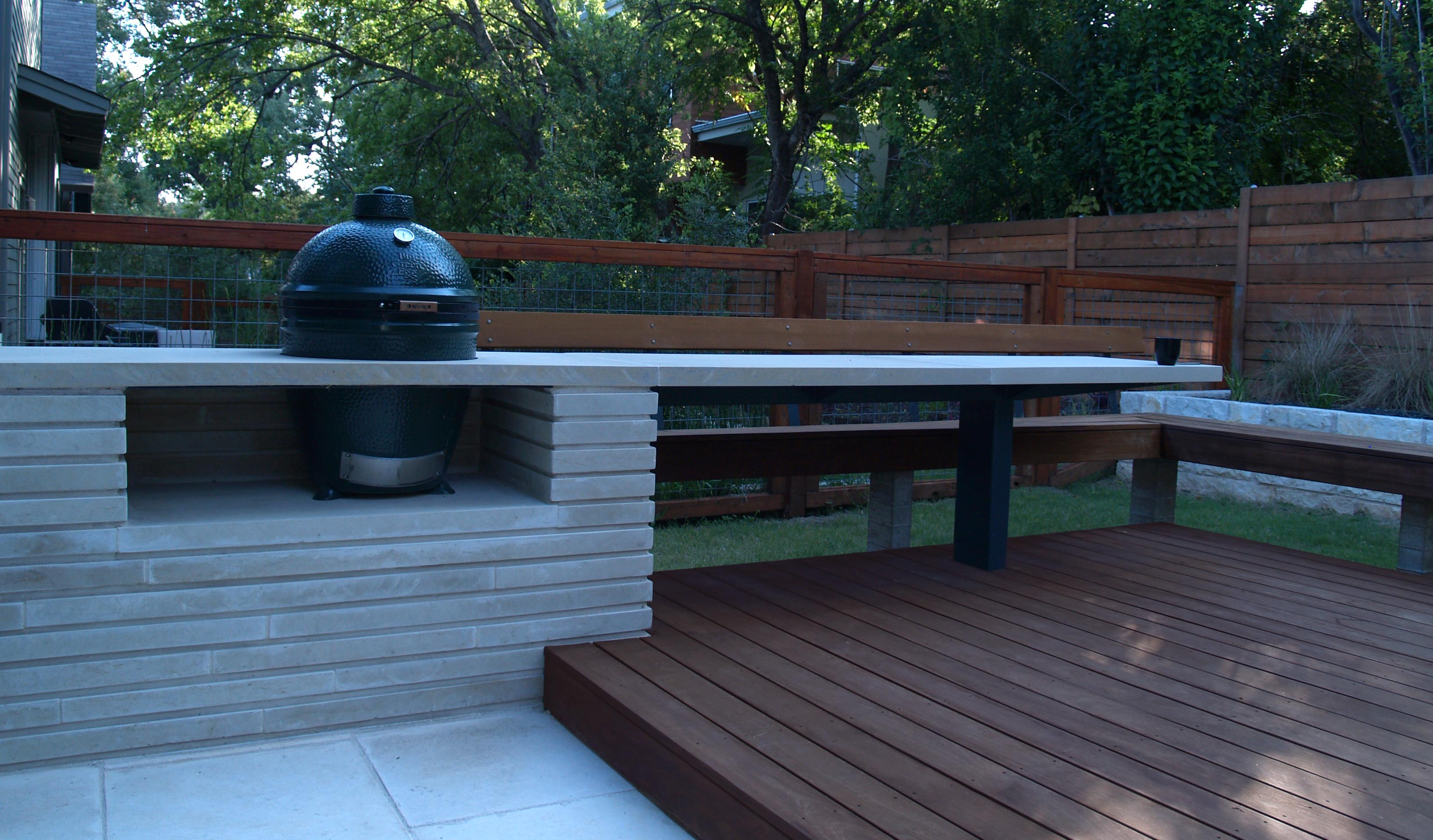 Big green egg nestled in a modern lueders limestone for Modern outdoor kitchen